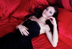 Girl in the red room Stock Image