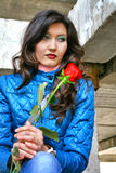 Girl with a red rose Royalty Free Stock Image