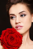 Girl with red rose. Portrait of young beautiful stylish woman with gorgeous red rose Stock Photography