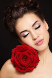 Girl with red rose. Portrait of young beautiful stylish woman with gorgeous red rose Royalty Free Stock Images