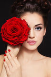 Girl with red rose. Portrait of young beautiful stylish woman with gorgeous red rose Royalty Free Stock Photo