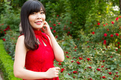 Girl in red at rose garden Stock Photography