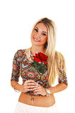 Girl with red rose. A lovely smiling young woman, holding a red rose in her hand, standing Royalty Free Stock Photos
