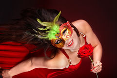Girl with red  rose and mask. Stock Image