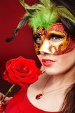 Girl with red  rose and mask. Royalty Free Stock Photography