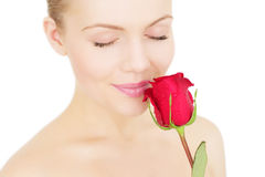 Girl with a red rose on white Royalty Free Stock Image
