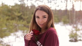 Girl with a red rose in the winter woods.Full hd video. stock footage
