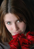 Girl with red roses stock images