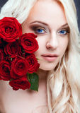 girl with red roses Royalty Free Stock Photo