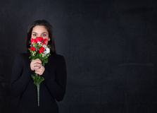 Girl with red roses on hand Royalty Free Stock Photos