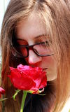 Girl with red roses Stock Image