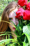 Girl with red roses Stock Photography