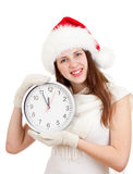 Girl in red Santa hat with clock over a white Royalty Free Stock Photography