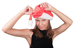 The girl in a red Santa's cap Stock Photography
