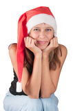 The girl in a red Santa's cap Stock Image