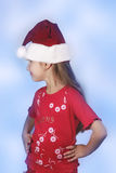 Girl in red santa's hat. Isolated Royalty Free Stock Photos