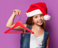 Girl in red Santas hat with hanger Royalty Free Stock Photography
