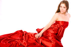 Girl in red satin river royalty free stock image