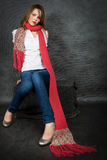 Girl with a red scarf Stock Image