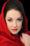 Girl in red scarf. Young woman in a red scarf on black Royalty Free Stock Images
