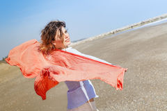 Girl With Red Scarf on The Beach Royalty Free Stock Image