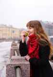 Girl in the red scarf with green apple. Beautiful girl in the red scarf and black coat  with green apple Royalty Free Stock Images