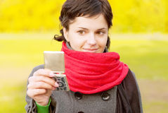 Girl with red scarf looks in mirror Royalty Free Stock Photography