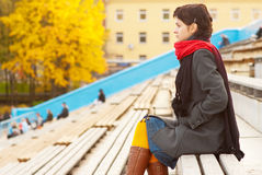 Girl with red scarf at stadium Stock Photography