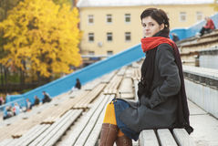 Girl with red scarf at stadium Royalty Free Stock Image
