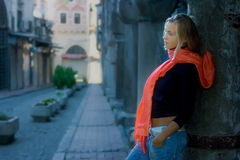 Girl in red scarf on street Stock Images