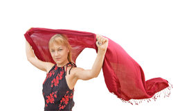 Girl with a red shawl. Girl holds scarf flying in the wind Royalty Free Stock Photos