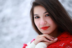 Girl in a red shawl Stock Images