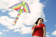 girl in red shirt flying kite Stock Photo