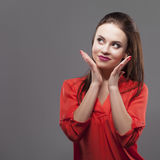 Girl in red shirt, gray background. Joyful young fashion brunette woman. Royalty Free Stock Images