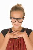 Girl in red shirt with hands folded and black trendy glasses Royalty Free Stock Image