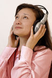 Girl in a red shirt with headphones Royalty Free Stock Photography