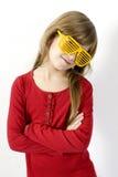 Girl in red shirt wearing strange yellow sunglasse Stock Image