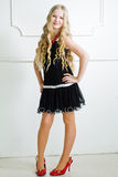 Girl in red shoes. Portrait beautiful girl with long blond hair Royalty Free Stock Photos
