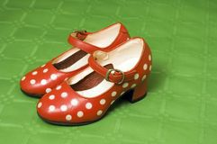 Girl red shoes. Red polka dot shoes Royalty Free Stock Photo