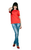 Girl in red shoes and blue jeans in the studio Stock Photo
