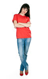 Girl in red shoes and blue jeans in the studio Royalty Free Stock Image