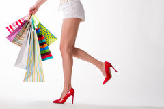 Girl in red shoes with shopping bags. Stock Images
