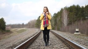 Girl in red shoes walking on the rails. stock video footage
