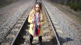 Girl in red shoes walking on the rails. stock footage
