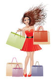 Girl in red with shopping bags Stock Image