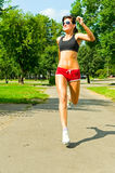 Girl in red shorts jogging Royalty Free Stock Photography