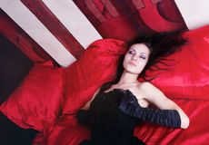Girl on the red silk Stock Image