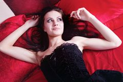 Girl on the red silk Stock Photography