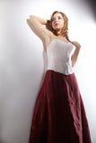 Girl in red skirt Stock Image