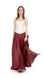 Girl in red skirt Stock Images